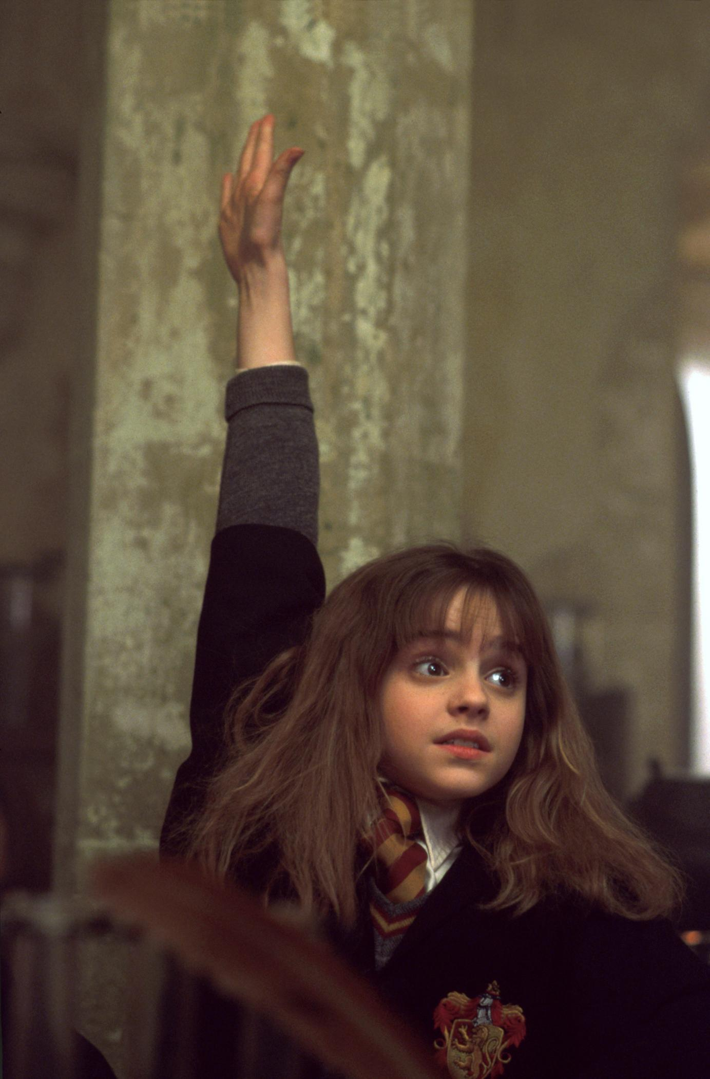 hermione-rasing-her-hand-harry-potter-movies-16644488-1383-2100
