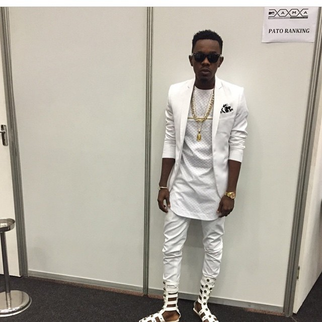 Patoranking fashion fail in white outfit and gladiators