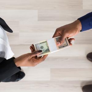 dollar exchanging hands money Zikoko
