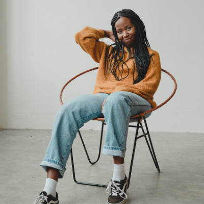 black girl sitting down and smiling