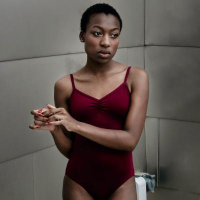 black woman in a bodysuit