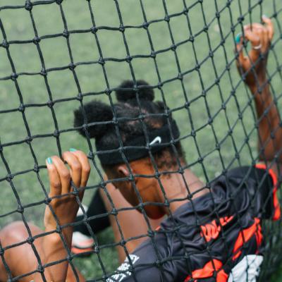 female footballer holding net