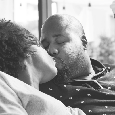 black man and woman kissing